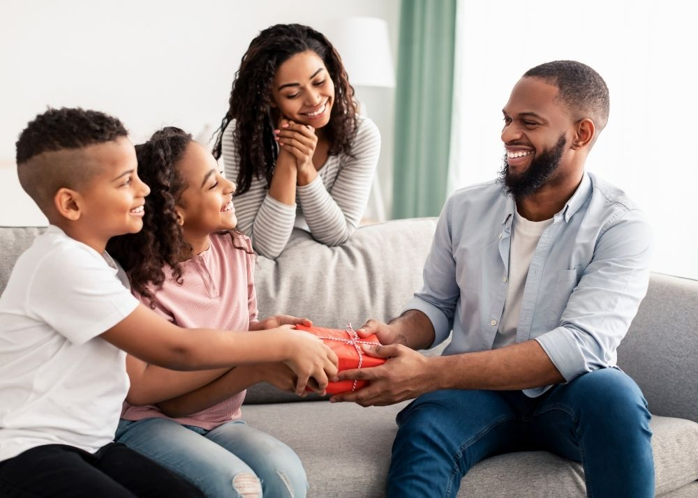 Family giving father or dad a gift